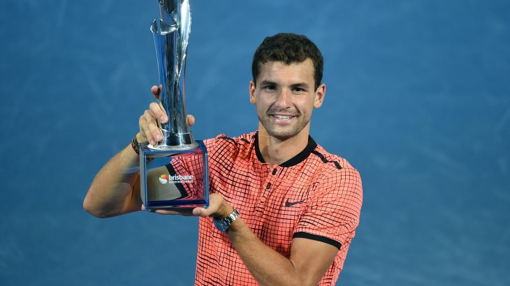 Grigor Dimitrov of Bulgaria lifts his winning trophy after defeating Kei Nishikori of Japan in their men's singles final at the Brisbane International tennis tournament in Brisbane on January 8, 2017. / AFP PHOTO / SAEED KHAN / IMAGE RESTRICTED TO EDITORIAL USE - STRICTLY NO COMMERCIAL USE