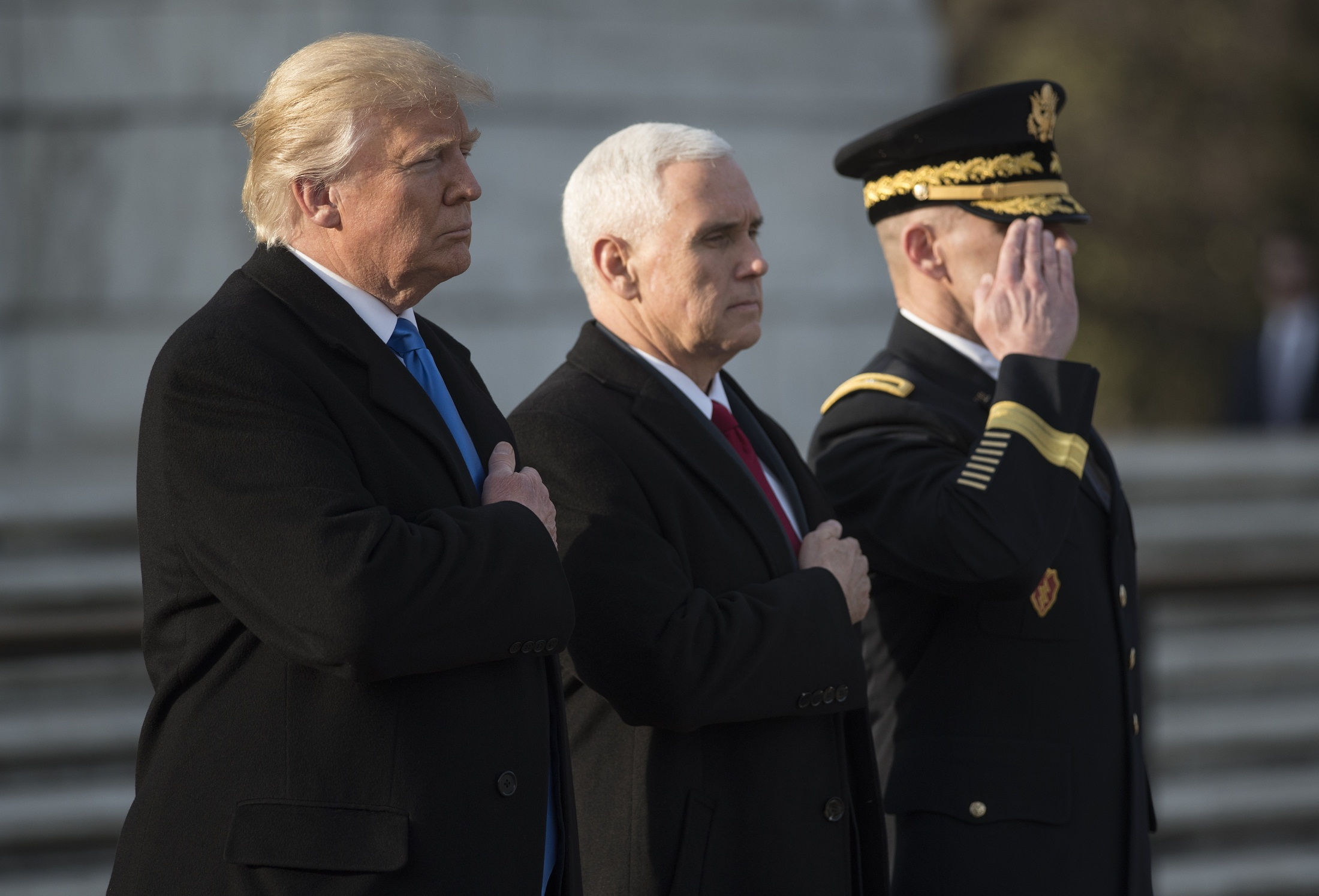 US President-elect Donald Trump and Vice President-elect Mike Pence take part in a wreath-laying ceremony at Arlington National Cemetery in Arlington, Virginia on January 19, 2017. / AFP PHOTO / Mandel Ngan