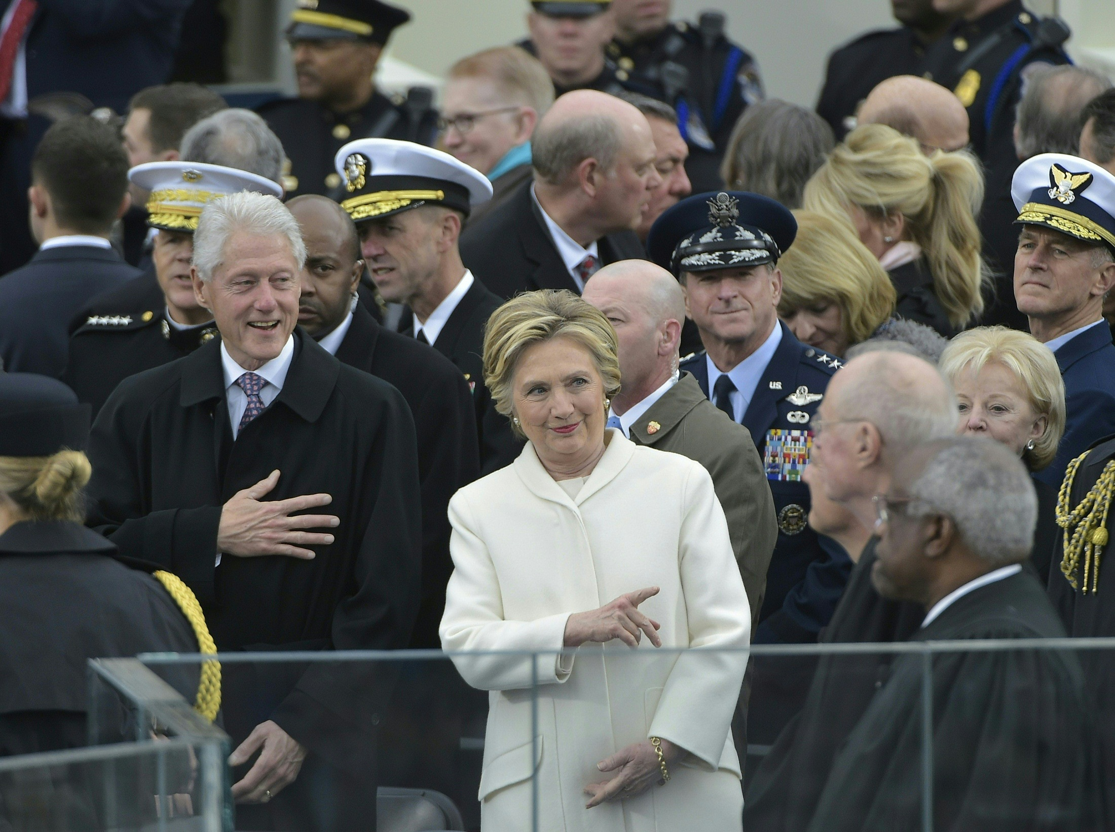 Former Democratic presidential candidate Hillary Clinton and former president Bill Clinton are seen amidst guests on the platform at the US Capitol in Washington, DC, on January 20, 2017, before the swearing-in ceremony of US President-elect Donald Trump. / AFP PHOTO / Mandel NGAN