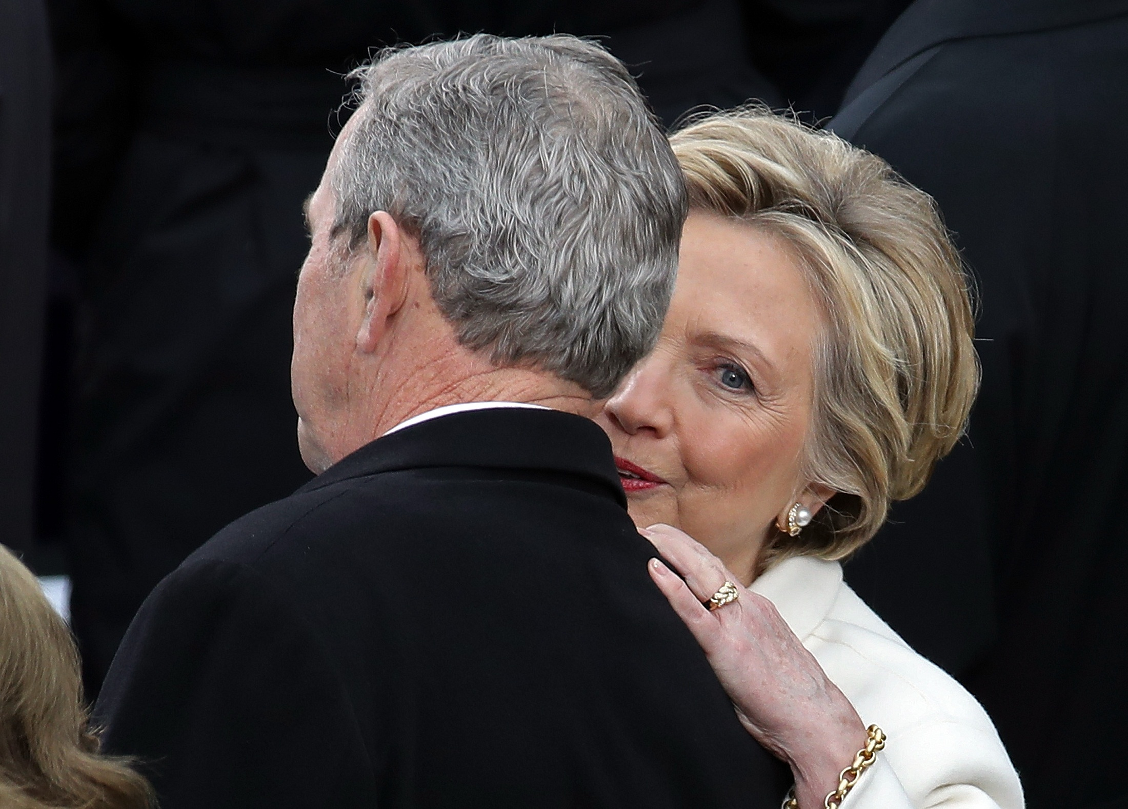 WASHINGTON, DC - JANUARY 20: Former Democratic presidential nominee Hillary Clinton (R) talks to former President George W. Bush arrives on the West Front of the U.S. Capitol on January 20, 2017 in Washington, DC. In today's inauguration ceremony Donald J. Trump becomes the 45th president of the United States.   Drew Angerer/Getty Images/AFP