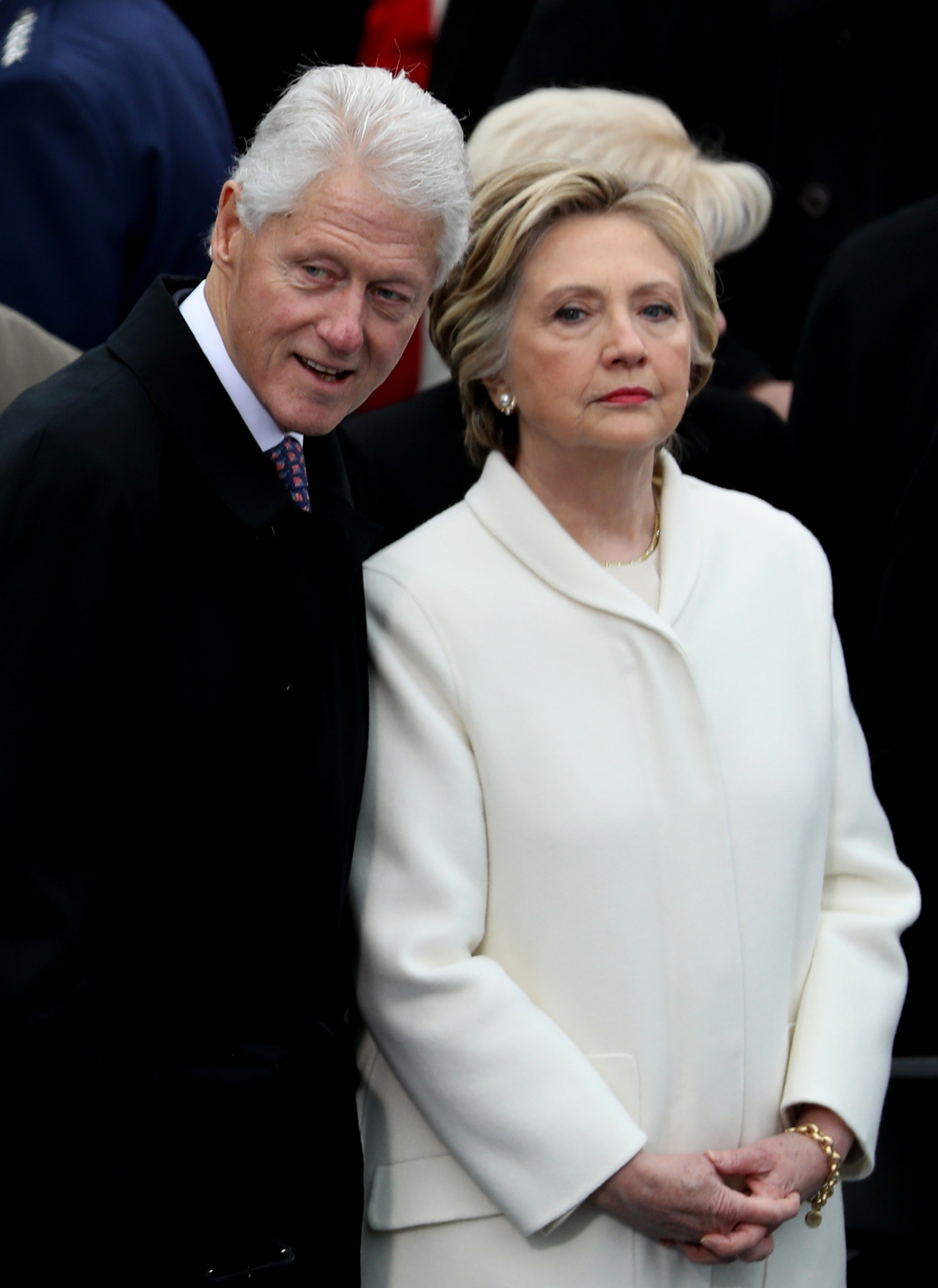 WASHINGTON, DC - JANUARY 20: Former President Bill Clinton and former Democratic presidential nominee Hillary Clinton stand on the West Front of the U.S. Capitol on January 20, 2017 in Washington, DC. In today's inauguration ceremony Donald J. Trump becomes the 45th president of the United States.   Joe Raedle/Getty Images/AFP