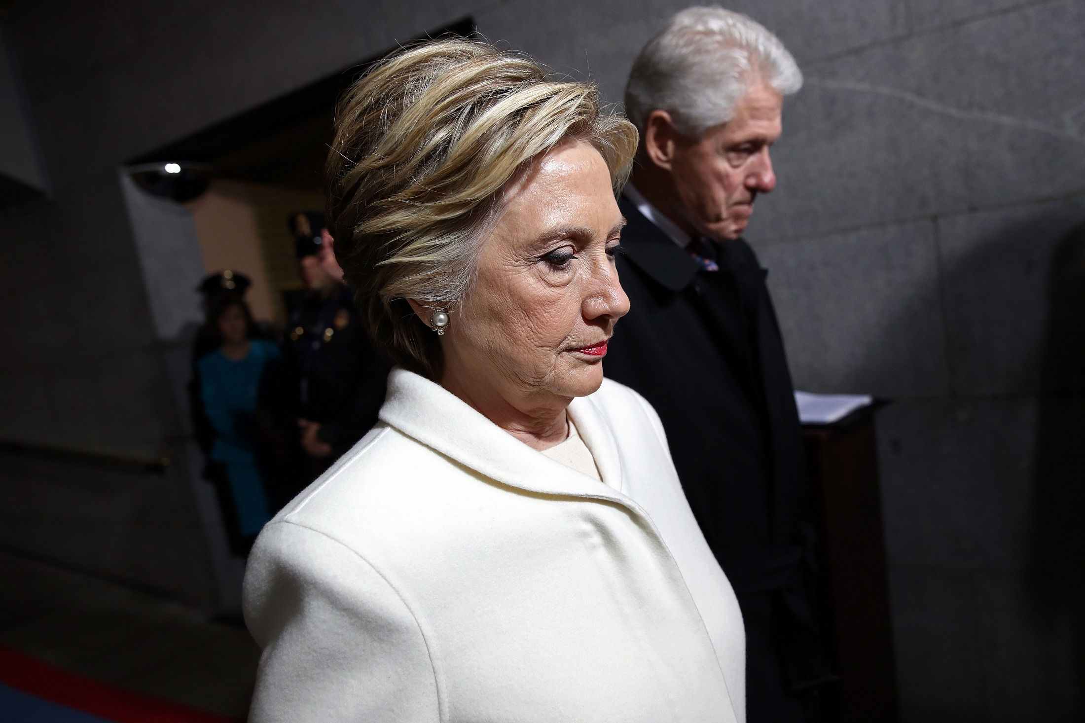 WASHINGTON, DC - JANUARY 20: Former Democratic presidential nominee Hillary Clinton (L) and former President Bill Clinton arrive on the West Front of the U.S. Capitol on January 20, 2017 in Washington, DC. In today's inauguration ceremony Donald J. Trump becomes the 45th president of the United States.   Win McNamee/Getty Images/AFP
