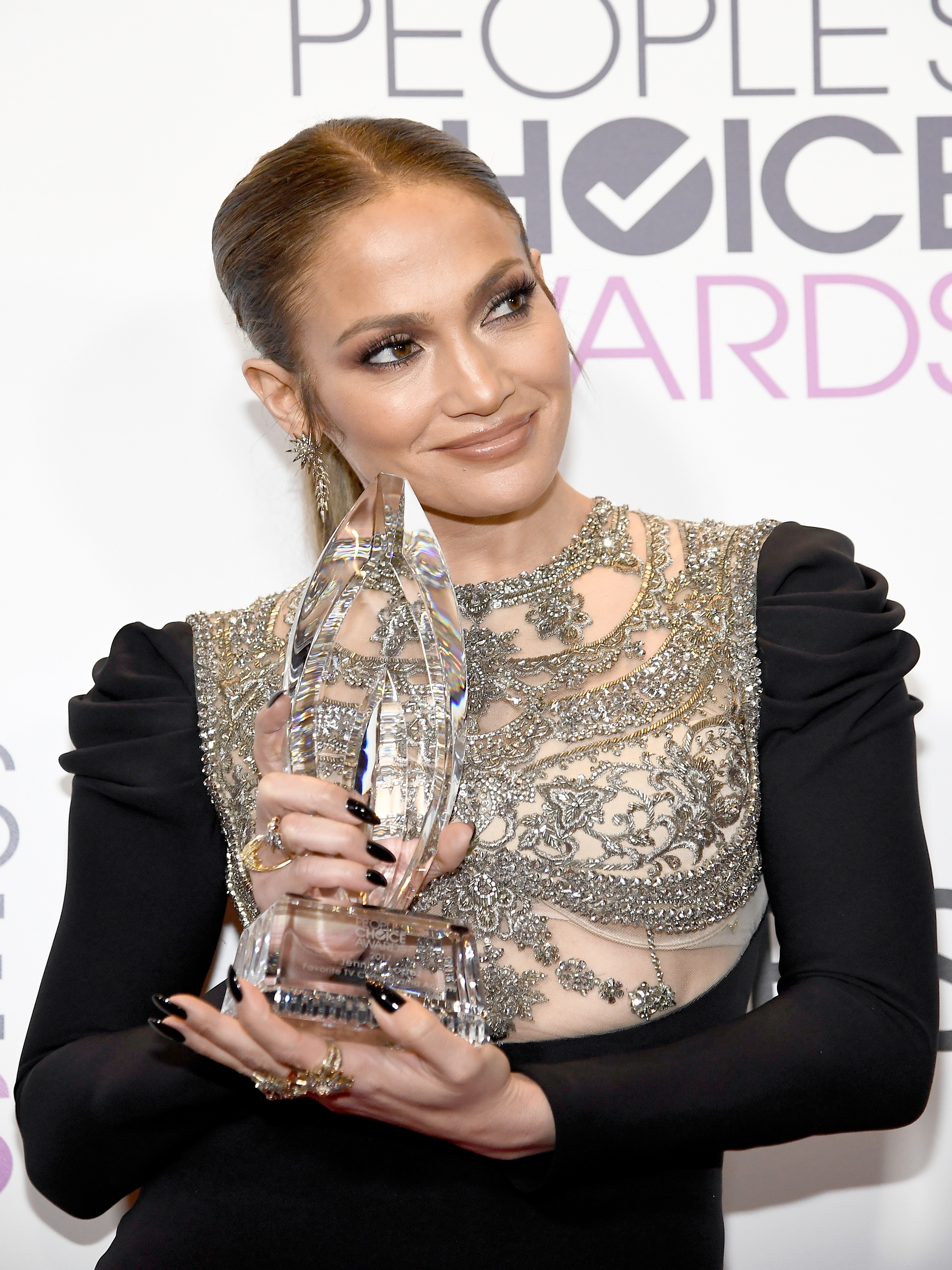 """LOS ANGELES, CA - JANUARY 18: Actress/recording artist Jennifer Lopez, winner of Favorite TV Crime Drama Actress award for """"Shades of Blue"""" poses in the press room at the People's Choice Awards 2017 at Microsoft Theater on January 18, 2017 in Los Angeles, California.   Kevork Djansezian/Getty Images/AFP"""