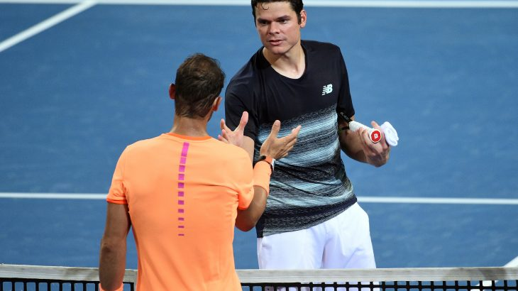 Milos Raonic of Canada shakes hand with Rafael Nadal (L) of Spain after their men's single quarter-final match at the Brisbane International tennis tournament in Brisbane on January 6, 2017. / AFP PHOTO / Saeed KHAN / IMAGE RESTRICTED TO EDITORIAL USE - STRICTLY NO COMMERCIAL USE
