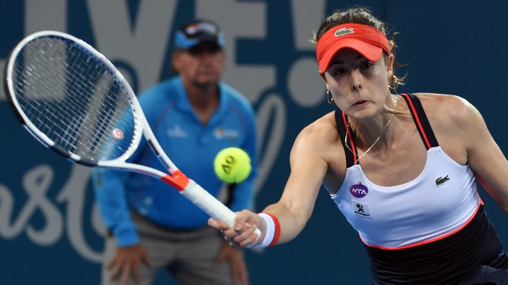 Alize Cornet of France hits a return against Karolina Pliskova of the Czech Republic in their women's singles final match at the Brisbane International tennis tournament in Brisbane on January 7, 2017. / AFP PHOTO / Saeed KHAN / IMAGE RESTRICTED TO EDITORIAL USE - STRICTLY NO COMMERCIAL USE