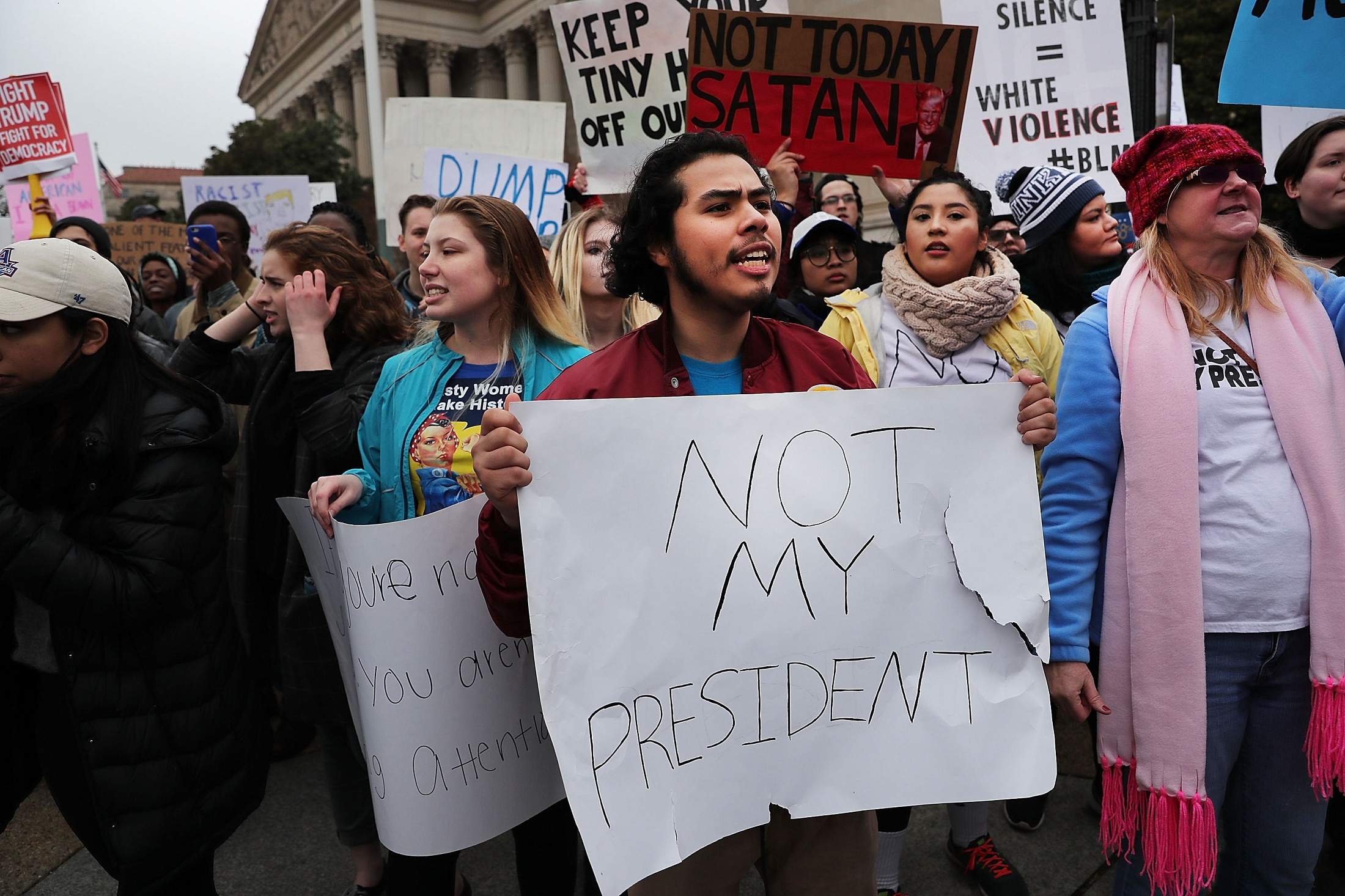 WASHINGTON, DC - JANUARY 20: Anti-Trump protesters demonstrate near the National Mall following the inauguration of President Donald Trump on January 20, 2017 in Washington, DC. Washington and the entire world have watched the transfer of the United States presidency from Barack Obama to Donald Trump, the 45th president.   Spencer Platt/Getty Images/AFP
