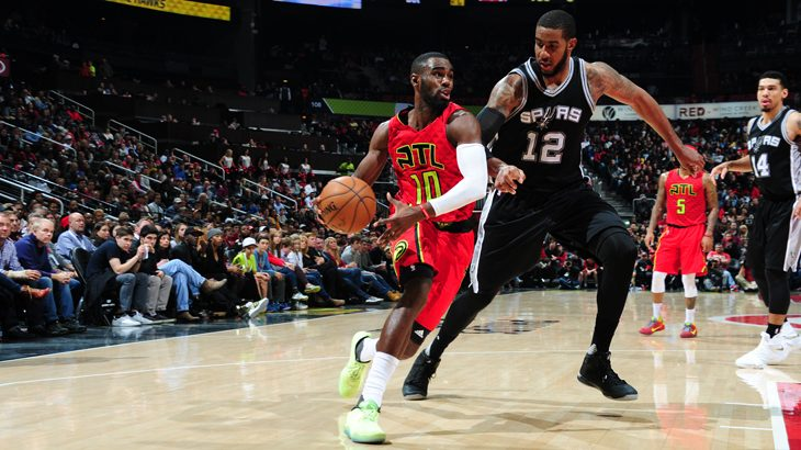 ATLANTA, GA - JANUARY 1: Tim Hardaway Jr. #10 of the Atlanta Hawks drives to the basket against the San Antonio Spurs on January 1, 2017 at Philips Arena in Atlanta, Georgia. NOTE TO USER: User expressly acknowledges and agrees that, by downloading and/or using this Photograph, user is consenting to the terms and conditions of the Getty Images License Agreement. Mandatory Copyright Notice: Copyright 2017 NBAE   Scott Cunningham/NBAE via Getty Images/AFP
