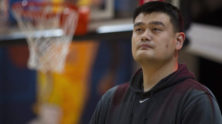 Former NBA player Yao Ming, of China, observes a national anthem before coaching a team in a NBA Cares Special Olympics unified basketball game during NBA All-Star weekend in Toronto on Saturday, Feb. 13, 2016. (Chris Young/The Canadian Press via AP) MANDATORY CREDIT