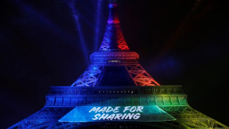 (FILES) This file photo taken on February 03, 2017 shows the Eiffel Tower illuminated with the colours of the Olympic flag and the slogan 'Made for Sharing' during the launch of the international campaign for Paris' bid to host the 2024 Olympic Games, in Paris.  A group of associations defending the French language will take legal action against the English slogan 'Made for Sharing', chosen to promote the candidacy of Paris for the 2024 Olympic Games, their lawyer announced on February 17, 2017. / AFP PHOTO / Patrick KOVARIK