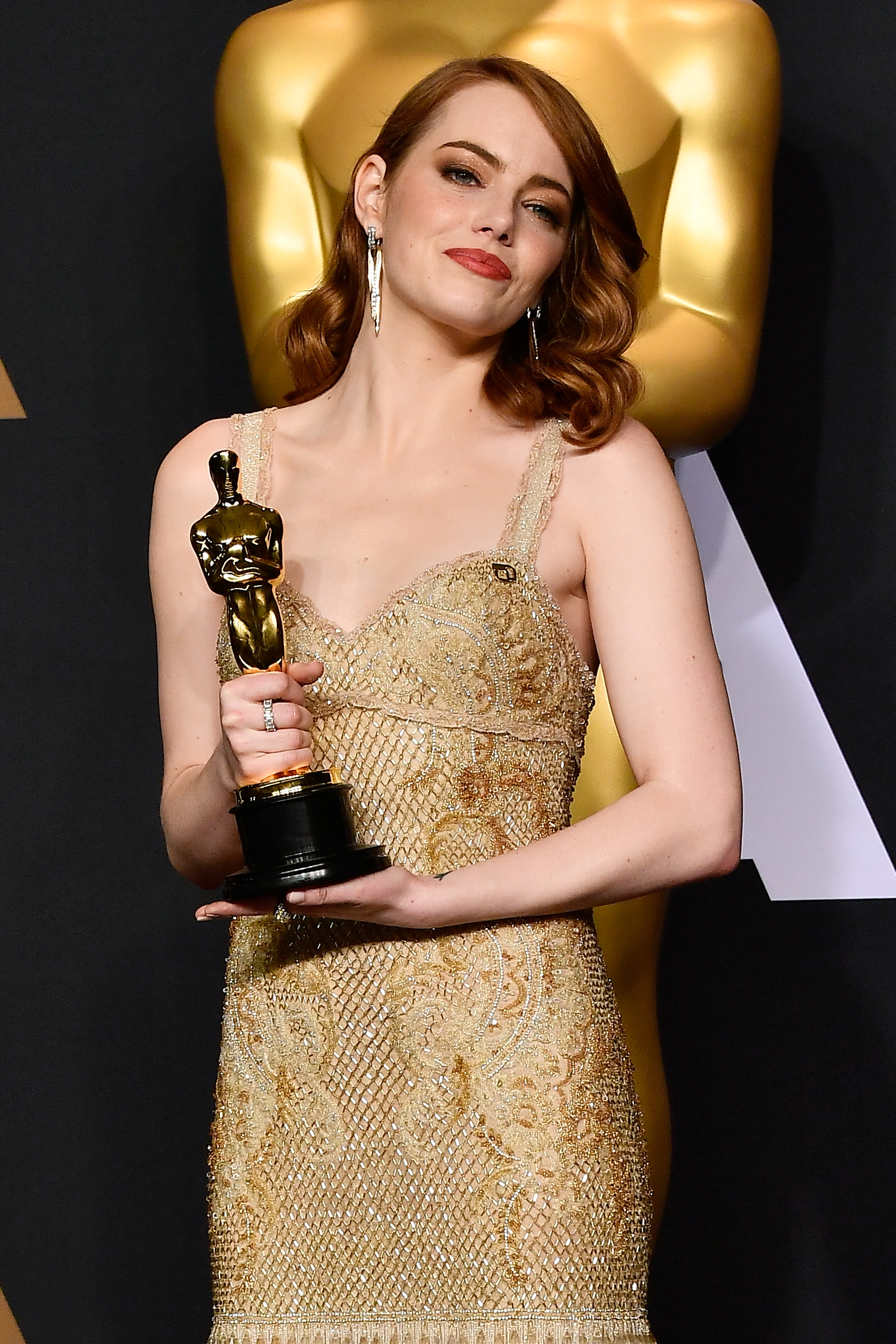 HOLLYWOOD, CA - FEBRUARY 26: Actress Emma Stone, winner of Best Actress for 'La La Land' poses in the press room during the 89th Annual Academy Awards at Hollywood & Highland Center on February 26, 2017 in Hollywood, California. Frazer Harrison/Getty Images/AFP