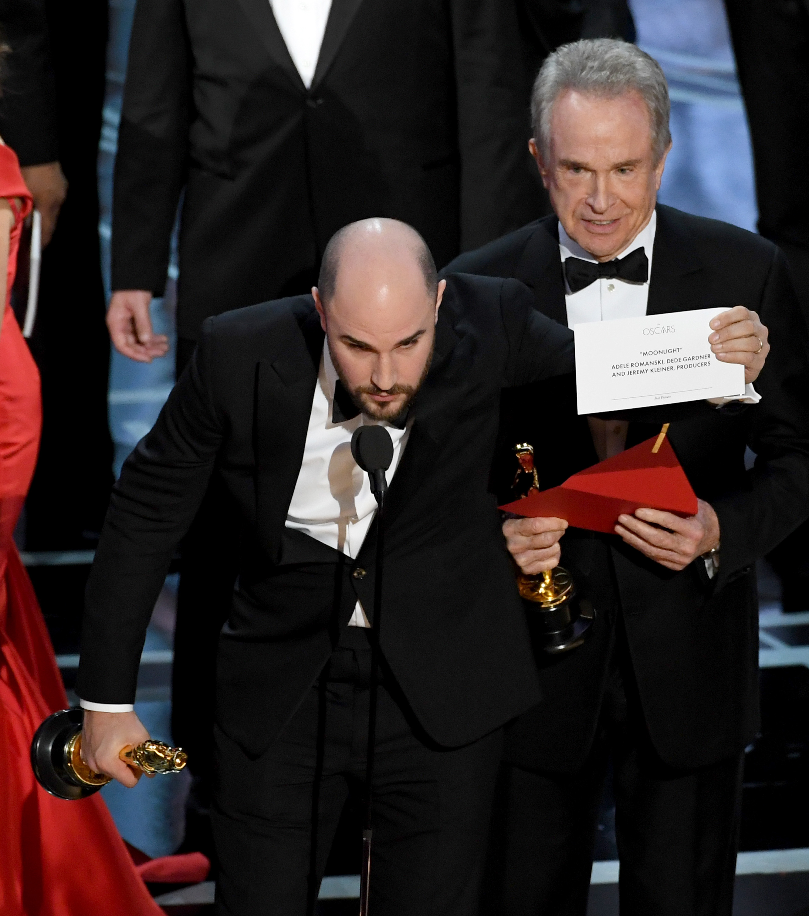 HOLLYWOOD, CA - FEBRUARY 26: 'La La Land' producer Jordan Horowitz (L) holds up the winner card reading actual Best Picture winner 'Moonlight' after a presentation error with actor Warren Beatty onstage during the 89th Annual Academy Awards at Hollywood & Highland Center on February 26, 2017 in Hollywood, California. Kevin Winter/Getty Images/AFP