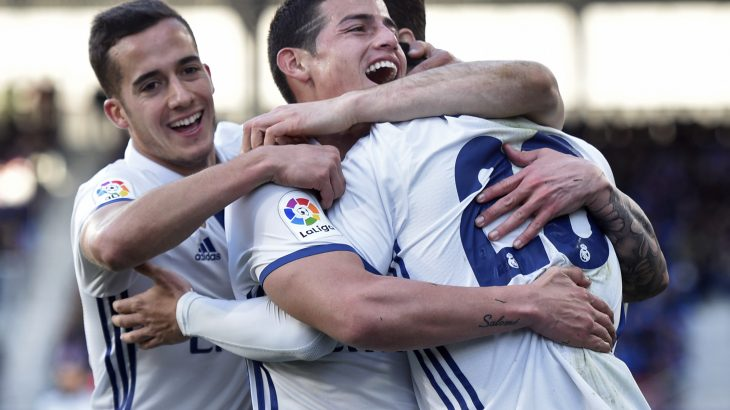 Real Madrid's midfielder Marco Asensio Willemsen (C) celebrates with teammates forward Lucas Vazquez (L) and Colombian midfielder James Rodriguez after scoring his team's fourth goal during the Spanish league football match SD Eibar vs Real Madrid CF at the Ipurua stadium in Eibar on March 4, 2017. / AFP PHOTO / ANDER GILLENEA