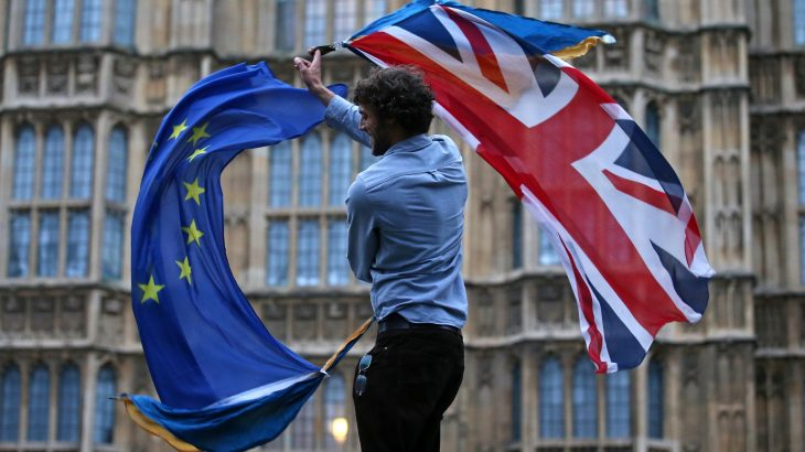 (FILES) This file photo taken on June 28, 2016 shows a man waving both a Union flag and a European flag together on College Green outside The Houses of Parliament at an anti-Brexit protest in central London on June 28, 2016. The British government is to activate Article 50 to formally begin the process of exiting the European Union on March 29, 2017, Downing Street announced. / AFP PHOTO / JUSTIN TALLIS